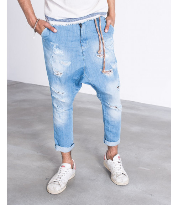Jeans a cavallo basso con strappi