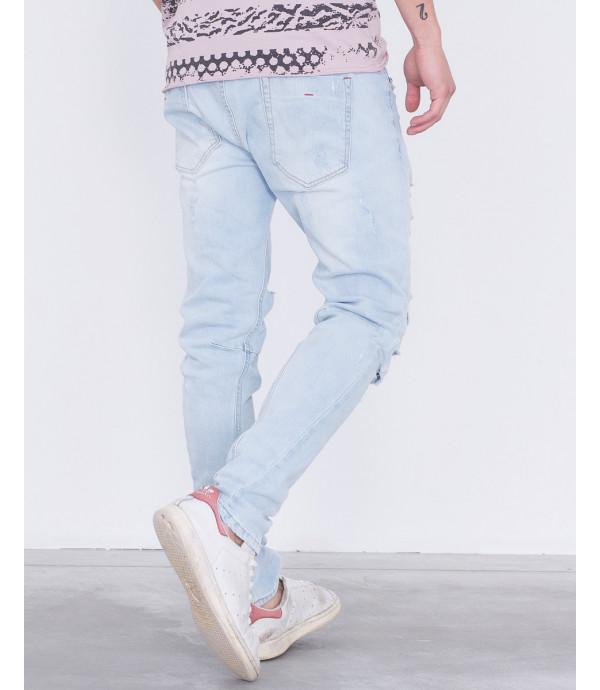 Jeans lavaggio chiaro carrot fit con strappi
