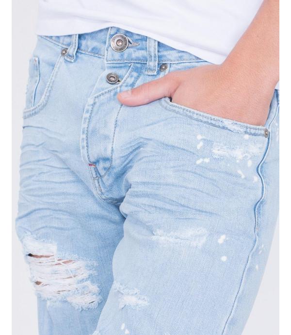 Jeans slim fit con strappi lavaggio chiaro
