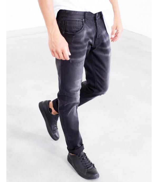 Jeans silm fit nero con strappo sul ginocchio
