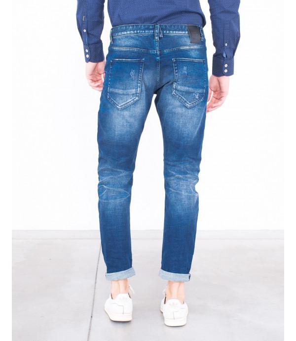 Jeans slim fit con effetto distressed
