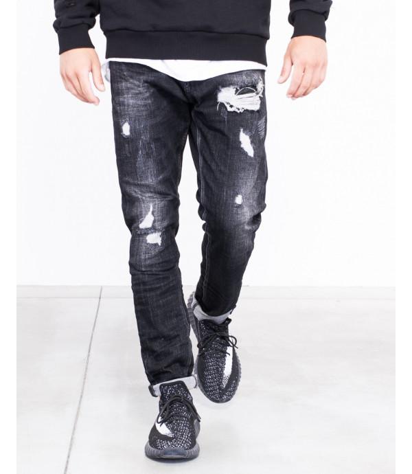 Jeans slim fit nero strappato