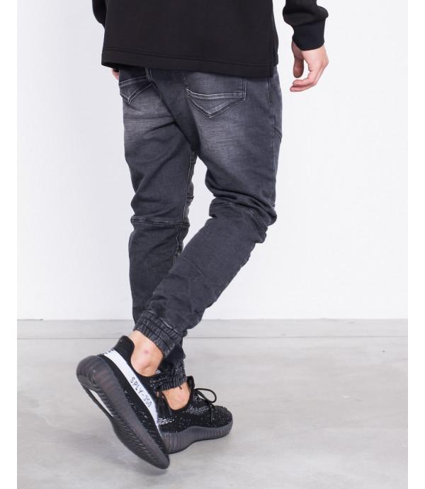 Jeans slim fit biker con pulsini