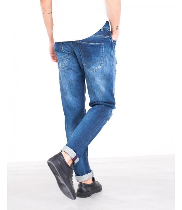 Jeans slim fit con strappi