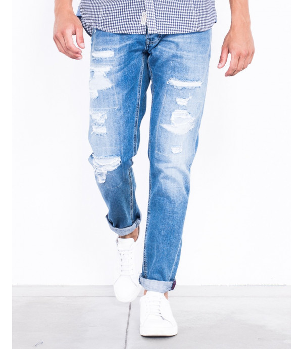 Jeans slim fit lavaggio chiaro con strappi
