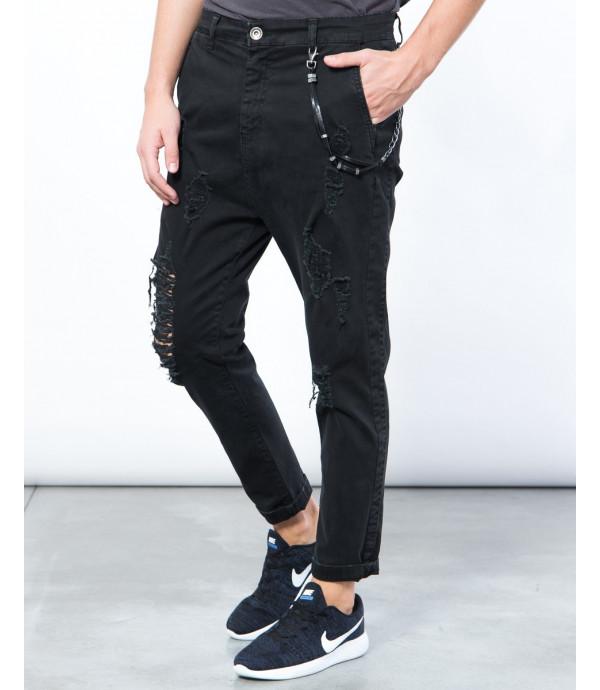 Jeans effetto consumato con strappi slim fit