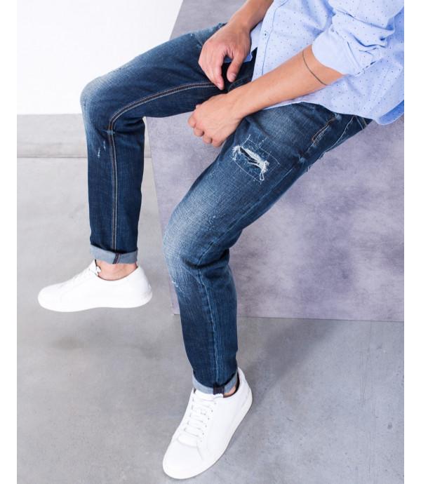 Jeans slim fit con strappi lavaggio scuro