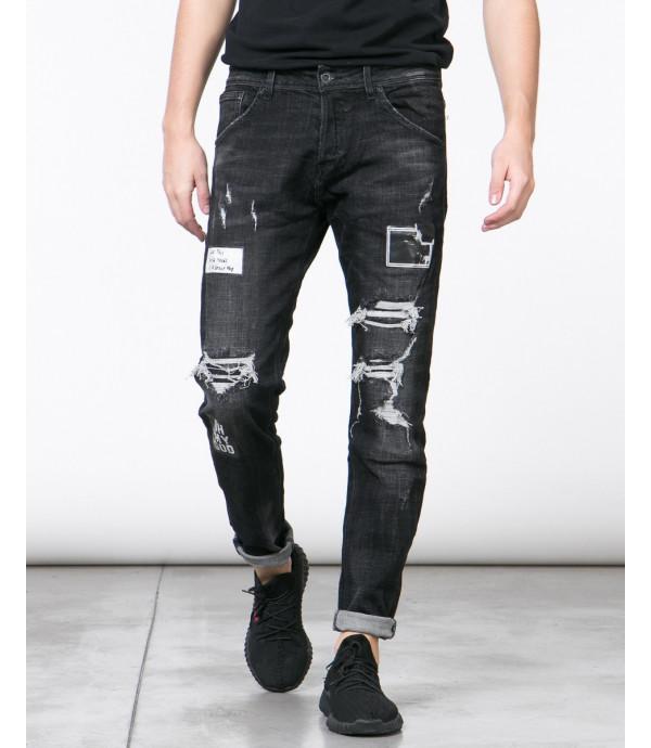Jeans nero carrot fit con strappi e stampe