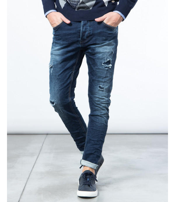 Jeans slim fit con patch e graffi