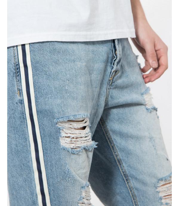 Jeans strappati carrot fit con bande laterali