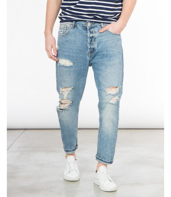 Jeans strappati carrot fit lavaggio chiaro