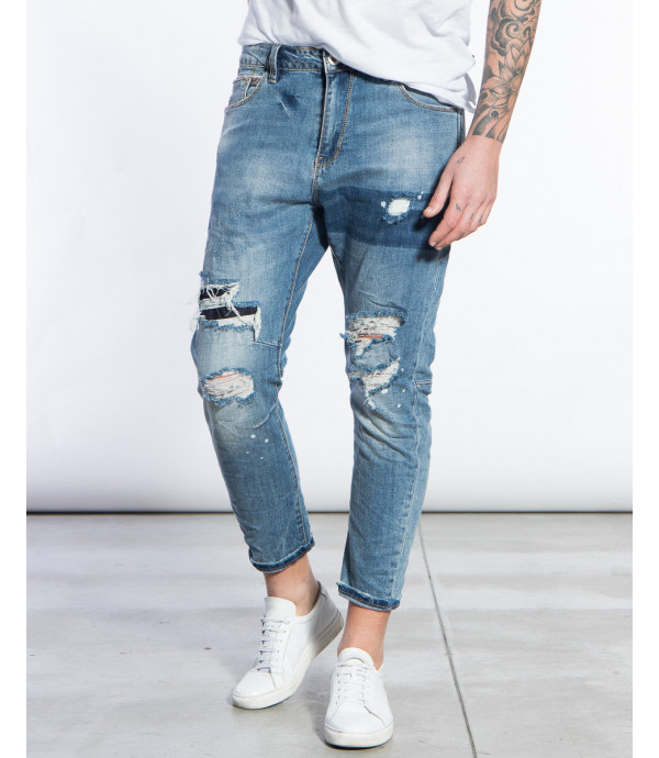 Jeans slim fit effetto distressed