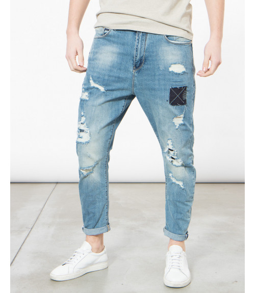 Jeans slim fit con strappi e patch