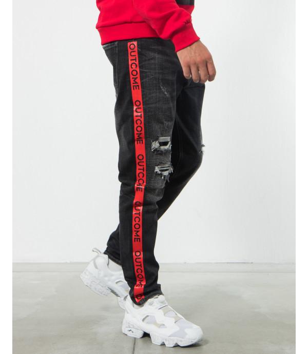 Jeans carrot fit strappati con banda