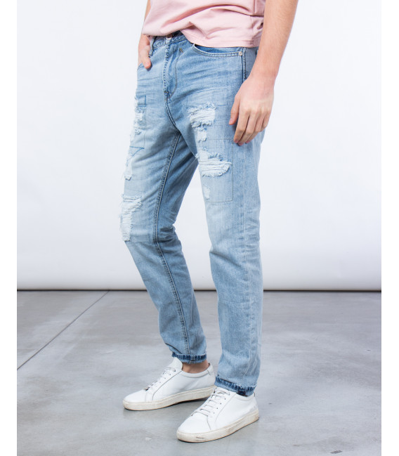 Jeans carrot fit effetto distressed