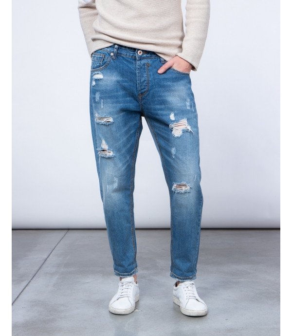 Carrot fit medium wash jeans with rips