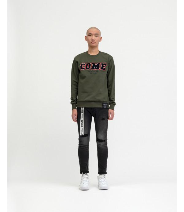 Jeans nero slim fit OUTCOME con strappi e cintura