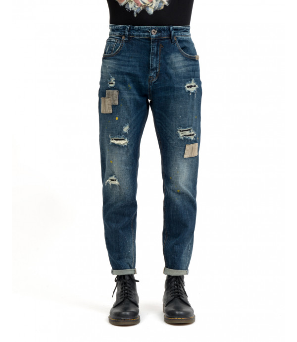 Medium wash carrot fit jeans with rips and patches