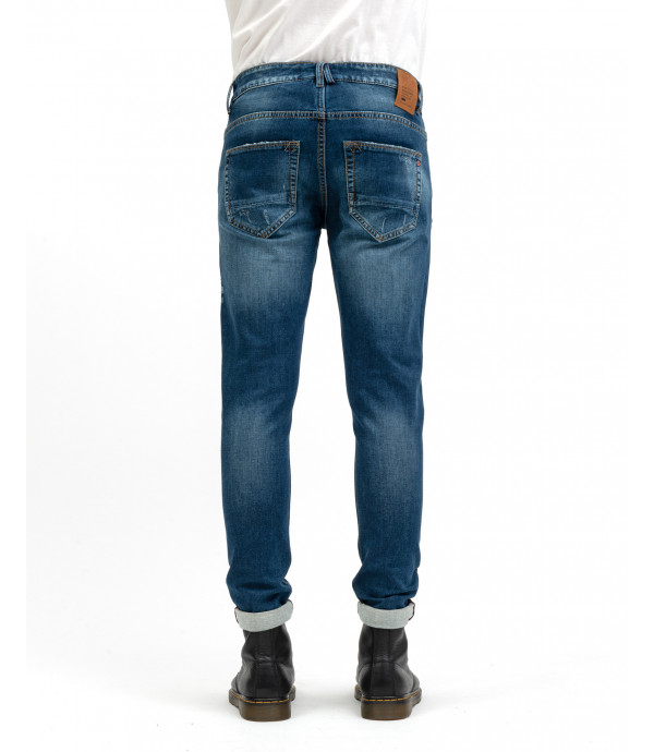 Jeans skinny fit con rotture e patch
