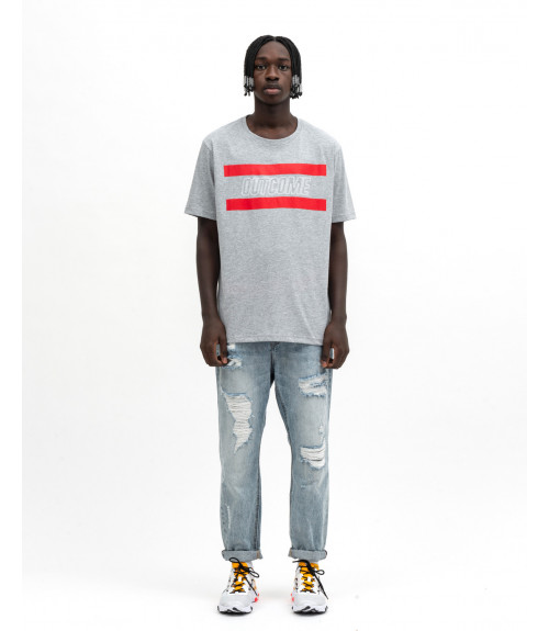 Bleached ripped carrot fit jeans with text
