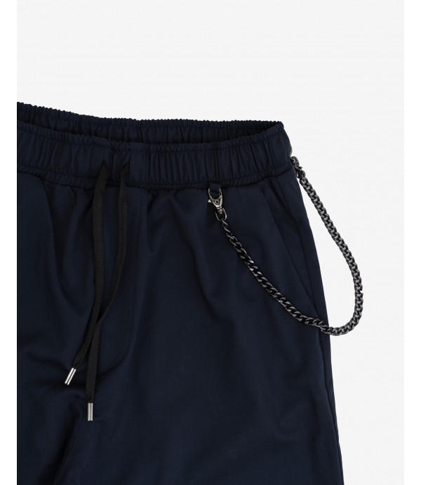 Trousers with chain