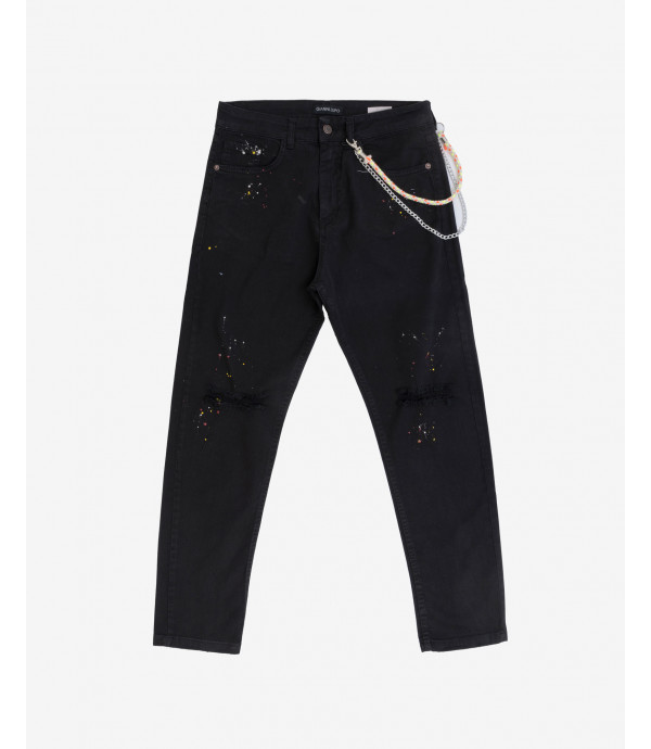 Carrot trousers with rips and paint splatter