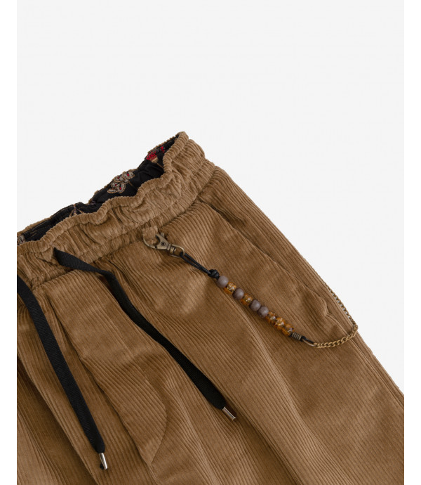 Drawstring trousers in corduroy with chain