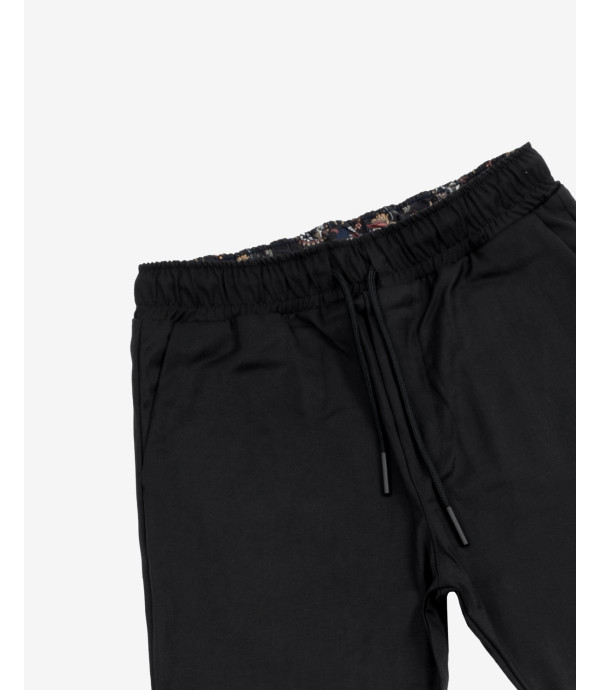 Drawstring trousers with printed lining