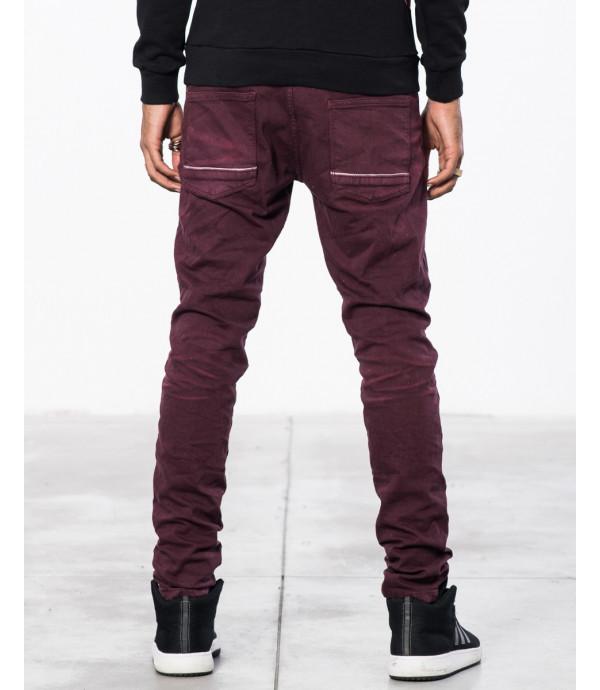 Jeans slim fit con strappi e graffi in tessuto puntinato