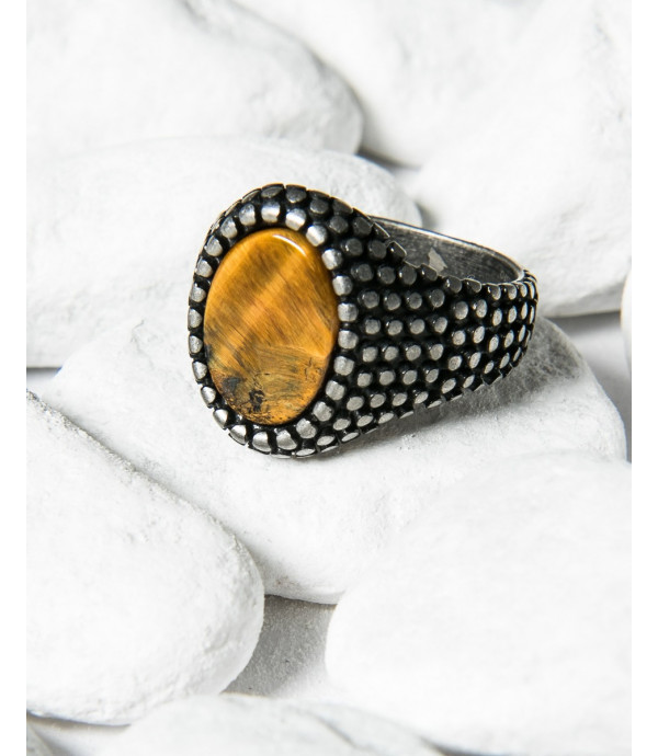 Oval spiked ring with stone