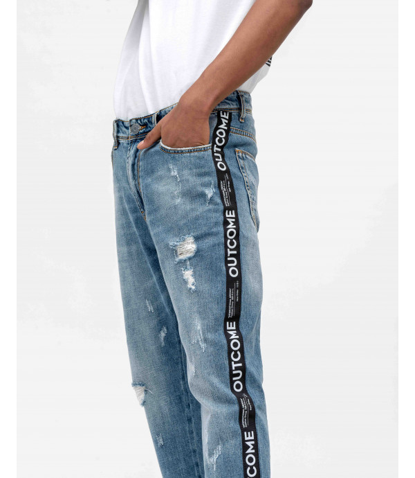 Carrot fit jeans with OUTCOME stripe and rips