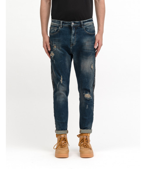 Jeans carrot fit OUTCOME medium wash con rotture