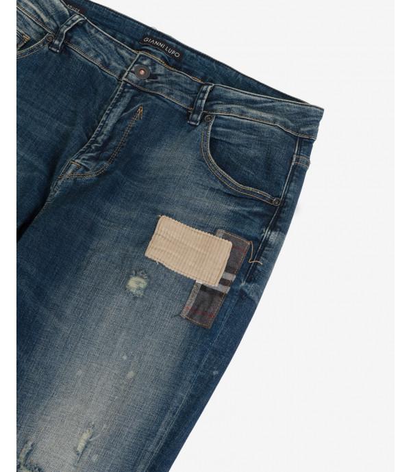 Jeans Kevin skinny fit lavaggio medio con rotture